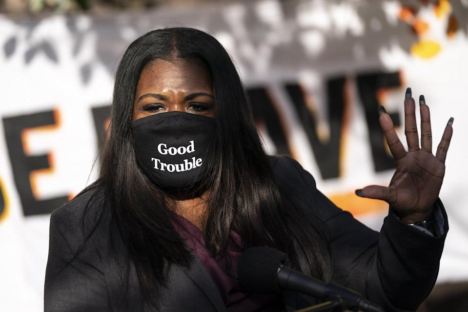 WASHINGTON, DC - NOVEMBER 19: Congresswoman-elect U.S. Rep. Cori Bush (D-MO) speaks outside of the Democratic National Committee headquarters on November 19, 2020 in Washington, DC. Rep. Bush, U.S. Rep. Alexandria Ocasio-Cortez and others called on the incoming administration of President-elect Joe Biden to take bold action on issues of climate change and economic inequalities. (Photo by Drew Angerer/Getty Images)