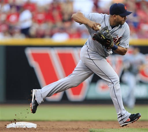 Detroit Tigers shortstop Jhonny Peralta looks to throw Cincinnati Reds' Ryan Hanigan out at first base after fielding a ground ball in the third inning of a baseball game, Friday, June 8, 2012, in Cincinnati. Hanigan was out, ending the inning. (AP Photo/Al Behrman)