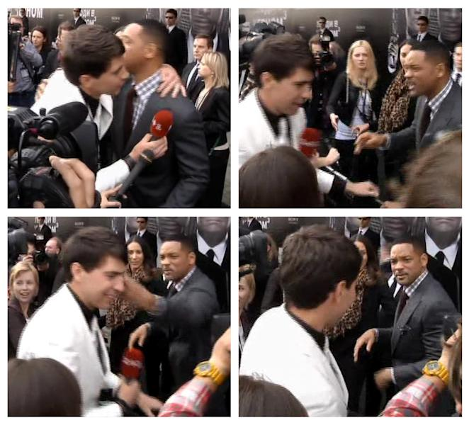 "In this photo combo from video images taken from AP video, top left image, U.S. actor Will Smith, center right, is embraced by reporter Vitalii Sediuk, white suit, from the Ukrainian television channel 1+1, on the red carpet before the premiere of ""Men in Black III"" Friday, May 18, 2012, in Moscow. At top right, Smith reacts after the two men embraced. In bottom left image, Smith slaps Sediuk after the male television reporter allegedly tried kissing Smith. In bottom right photo, Smith walks away from Sediuk. (AP Photo via AP video)"