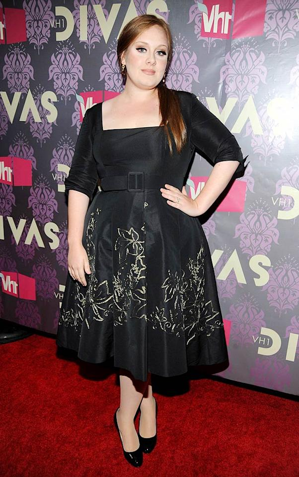 "British singer-songwriter Adele donned a belted black frock and side ponytail to belt out her song ""Hometown Glory"" for the crowd. Kevin Mazur/<a href=""http://www.wireimage.com"" target=""new"">WireImage.com</a> - September 17, 2009"