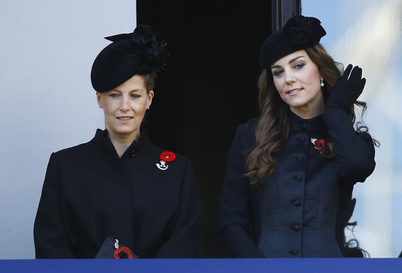 Britain's Kate, the Duchess of Cambridge, right, and Sophie, the Countess of Wessex listen from a balcony during the service of remembrance at the Cenotaph in Whitehall, London, Sunday, Nov. 10, 2013. The annual remembrance service is to remember those who have lost their lives serving in the Armed Forces. (AP Photo/Kirsty Wigglesworth)