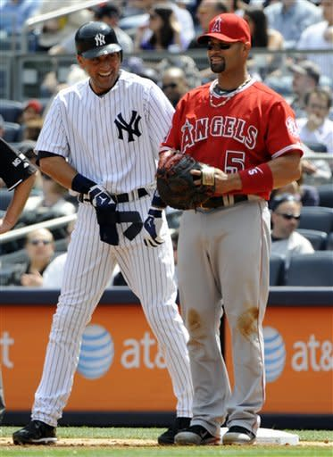 New York Yankees' Derek Jeter, left, talks with Los Angeles Angels first baseman Albert Pujols after Jeter singled during the first inning of a baseball game Saturday, April 14, 2012 at Yankee Stadium in New York. (AP Photo/Bill Kostroun)
