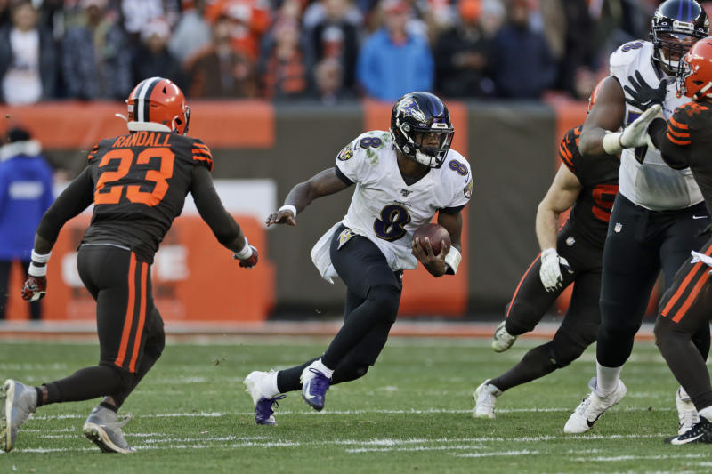 Baltimore Ravens quarterback Lamar Jackson (8) scrambles against the Cleveland Browns during the second half of an NFL football game, Sunday, Dec. 22, 2019, in Cleveland. The Ravens won 31-15. (AP Photo/Ron Schwane)