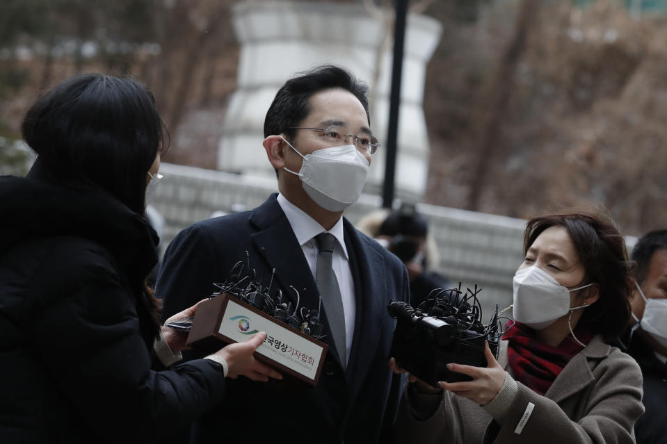 Samsung Electronics Vice Chairman Lee Jae-yong is questioned by reporters upon his arrival at the Seoul High Court in Seoul, South Korea, Monday, Jan. 18, 2021. South Korean court sentences Lee to 2 and a half years in prison over corruption case. (AP Photo/Lee Jin-man)