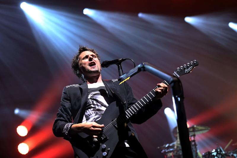 Singer Matthew Bellamy of the British rock band Muse performs on stage at the Olympia concert hall in Paris, France, October 2, 2012