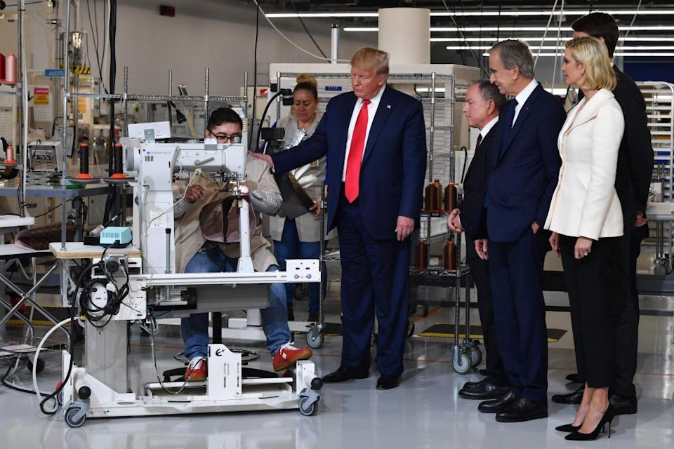US-LUXURY-GOVERNMENT-VUITTON-TRUMP(FromR) Ivanka Trump, advisor to the US president, Alexandre Arnault, Chief Executive of LVMH (Louis Vuitton Moet Hennessy) Bernard Arnault, CEO of Louis Vuitton Michael Burke and US President Donald Trump visit the new Louis Vuitton factory in Alvarado (40 miles south of Fort Worth), Johnson County, Texas on October 17, 2019. - A workshop of the French brand Louis Vuitton will be inaugurated in Texas by Donald Trump, in the presence of Bernard Arnault, CEO of LVMH, who had indicated to the American President in 2017 that he was ready to invest more in the United States. (Photo by Nicholas Kamm / AFP) (Photo by NICHOLAS KAMM/AFP via Getty Images)