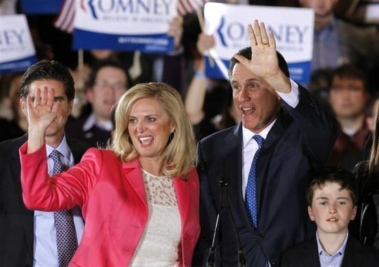 """Mitt Romney waves with his wife Ann at his """"Super Tuesday"""" primary election night rally in Boston, March 6, 2012."""