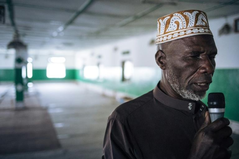 The muezzin at the Katindo mosque in Goma, northeastern DR Congo, called for prayers in a deserted house of worship on Sunday after the authorities appealed for social distancing (AFP Photo/ALEXIS HUGUET)