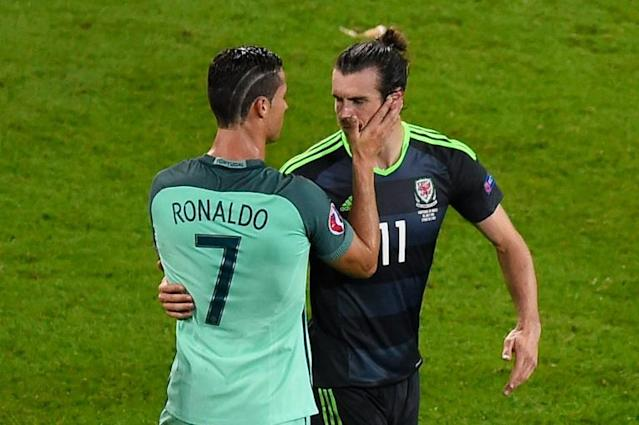 Portugal's Cristiano Ronaldo (L) comforts Wales player Gareth Bale after their Euro 2016 semi-final in France on July 6, 2016, won 2-0 by Portugal (AFP Photo/Romain LaFabregue)