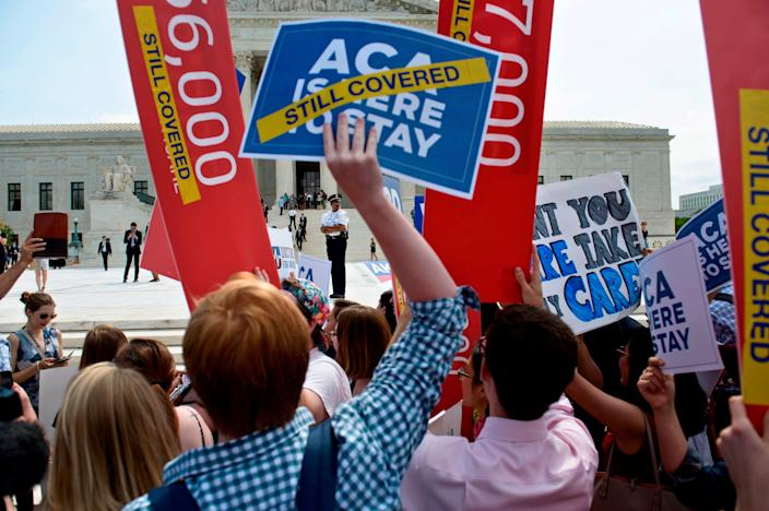 Supporters of the Affordable Care Act rally outside the Supreme Court in 2015.