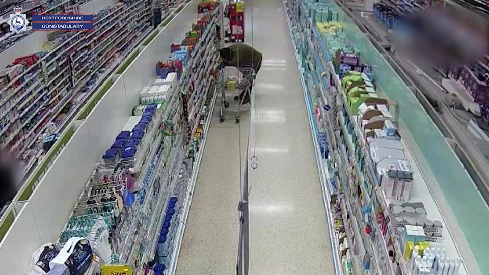 Wright in a Tesco store where he planted contaminated food. (SWNS)
