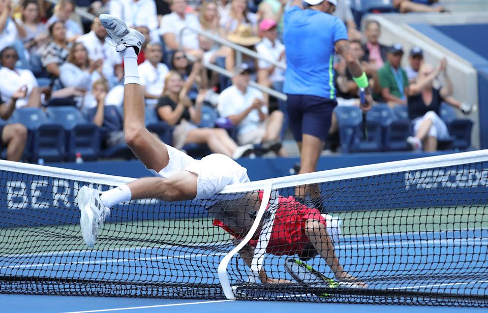 Oscar Otte (pictured) falls over the net while playing against Matteo Berrettini at the US Open.