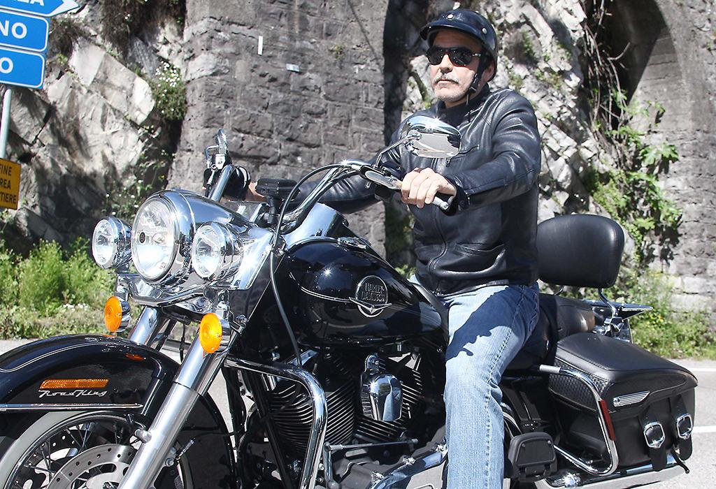 Who's that motorcycle man? Would you believe that it's George Clooney? The hunky 52-year-old took a cruise around Lake Como, Italy, on Sunday. We must admit: We're not so sure about that stache, George! (5/12/2013)