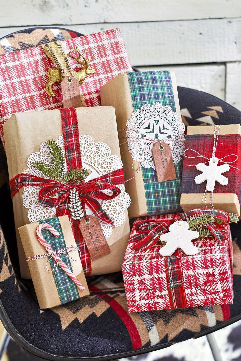 <p>To experiment with a country-inspired gift-wrapping look, cut strips out of your unwanted plaid shirts (make sure the pattern appears inside and out). Next, create a fringe effect by pulling the loose threads. You can even sew multiple pieces together to lengthen the stripes if necessary. Tie your plaid strips around your presents and spruce them up with doilies, candy canes, and ornaments.</p>
