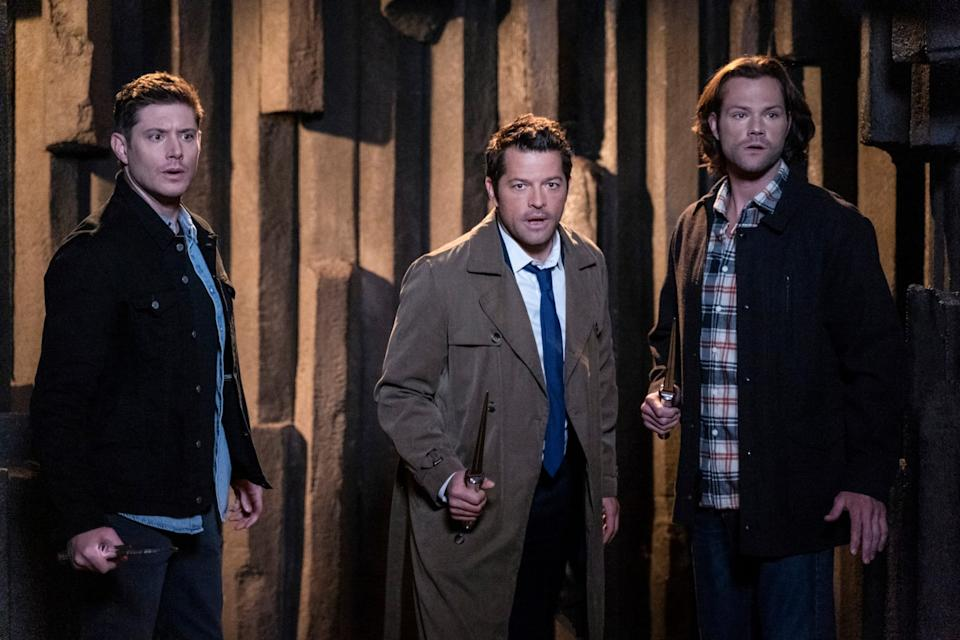 SUPERNATURAL, from left: Jensen Ackles, Misha Collins, Jared Padalecki, 'Our Father, Who Aren't in Heaven', (Season 15, Episode 1508, aired Dec. 12, 2019), photo: Colin Bentley / The CW / Courtesy Everett Collection