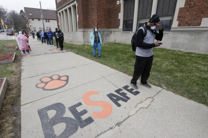 Voters line up at Riverside High School for Wisconsin's primary election Tuesday April 7, 2020, in Milwaukee. / Credit: Morry Gash / AP
