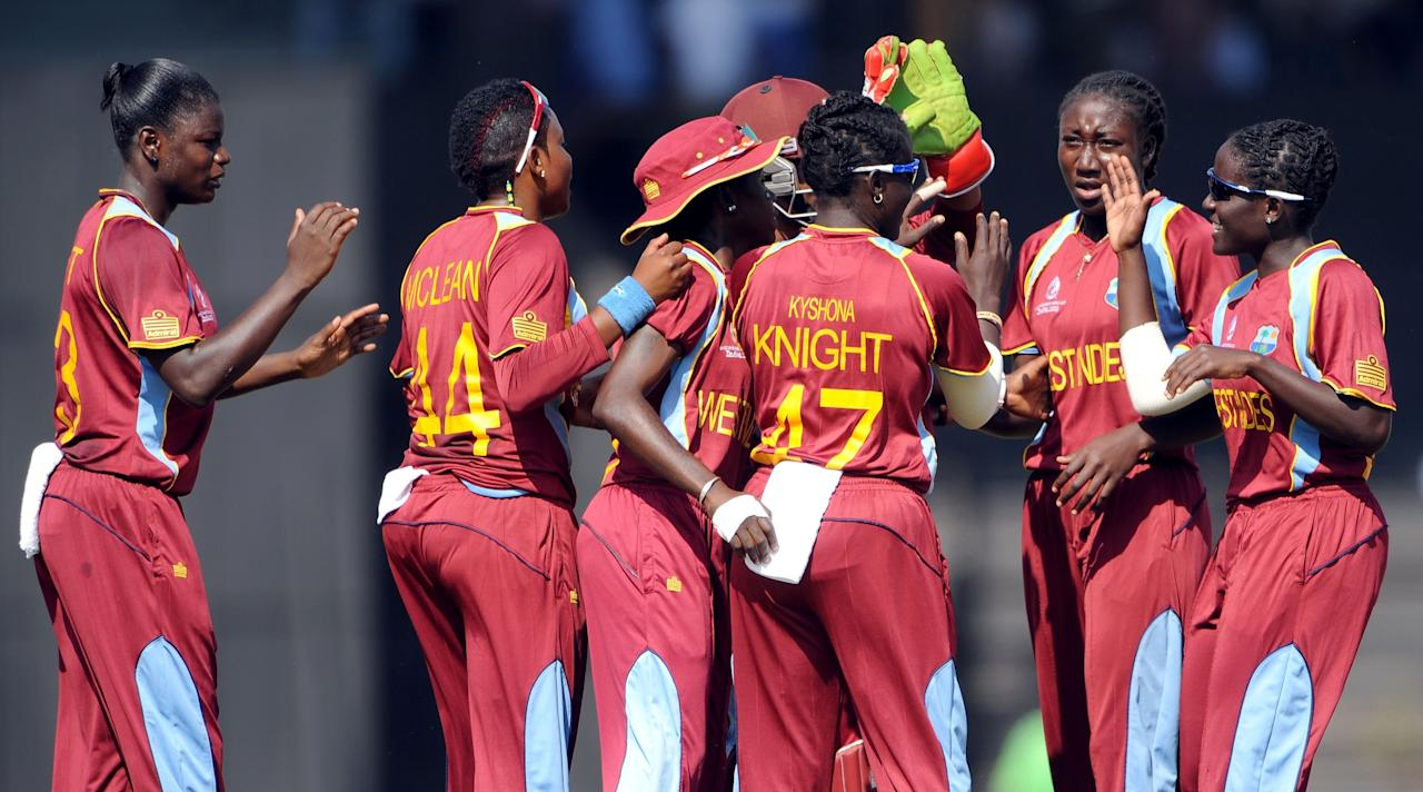 West Indian cricketers celebrate the wicket of Australian cricketer Meg Lanning during the final match of the ICC Women's World Cup 2013 between Australia and West Indies at the Cricket Club of India's Brabourne stadium in Mumbai on February 17, 2013. AFP PHOTO/Indranil MUKHERJEE        (Photo credit should read INDRANIL MUKHERJEE/AFP/Getty Images)