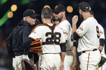 Jun 18, 2018; San Francisco, CA, USA; San Francisco Giants pitching coach Curt Young (left) talks to relief pitcher Hunter Strickland (60) and catcher Buster Posey (28) before the pitch against the Miami Marlins in the ninth inning at AT&T Park. Mandatory Credit: John Hefti-USA TODAY Sports