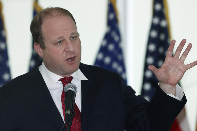 Colorado Governor Jared Polis speaks during a news conference to update the state's efforts to stop the spread of the new coronavirus Wednesday, April 22, 2020, in Denver. (AP Photo/David Zalubowski)