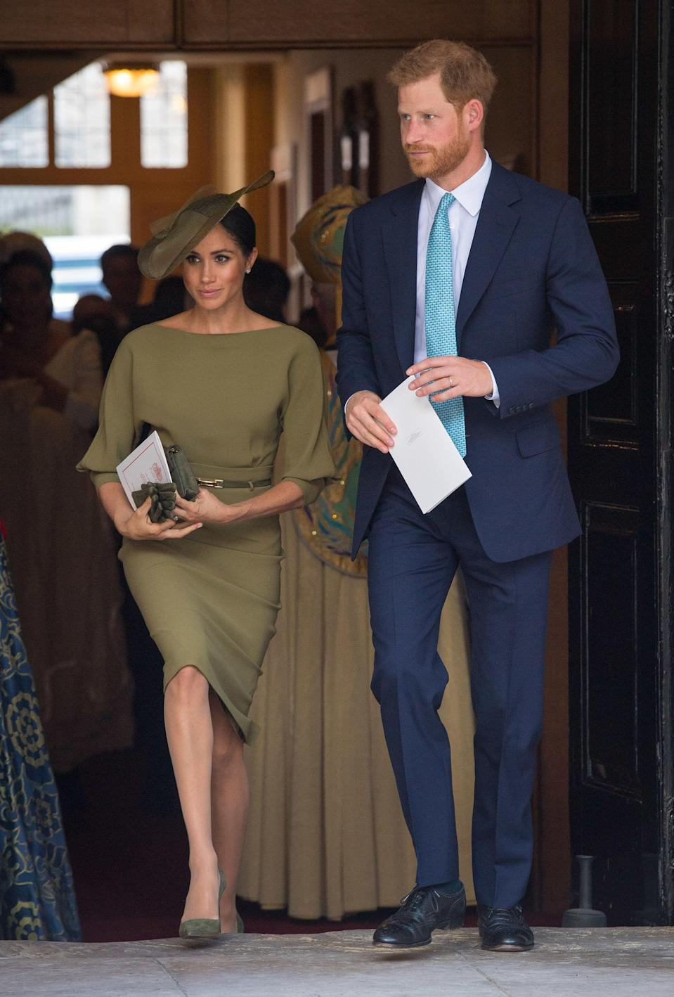<p>For Prince Louis' christening, the Duchess flew the American flag in a khaki-hued Ralph Lauren dress with a matching Stephen Lock hat and Manolo Blahnik heels. <em>[Photo: Getty]</em> </p>