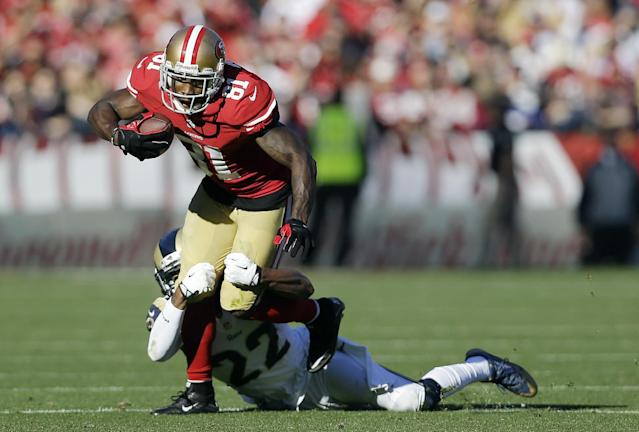 San Francisco 49ers wide receiver Anquan Boldin (81) is tackled by St. Louis Rams cornerback Trumaine Johnson (22) during the second quarter of an NFL football game in San Francisco, Sunday, Dec. 1, 2013. (AP Photo/Marcio Jose Sanchez)