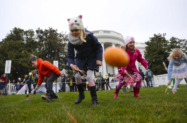 <p>Julia Stimson, 8, from Alexandria, Va., and other children participate in the annual White House Easter Egg Roll on the South Lawn of the White House in Washington, Monday, April 2, 2018. (Photo: Pablo Martinez Monsivais) </p>