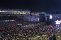 Fans fill the stadium as New Zealand band Six60 perform at Eden Park in Auckland, New Zealand, Saturday, April 24, 2021. Six60 is being billed as the biggest live act in the world since the coronavirus pandemic struck after New Zealand stamped out the spread of the virus, allowing life to return to normal. On Saturday, the band played a remarkable finale to their latest tour, performing in front of 50,000 people at the first-ever concert at Auckland's Eden Park. (AP Photo/David Rowland)