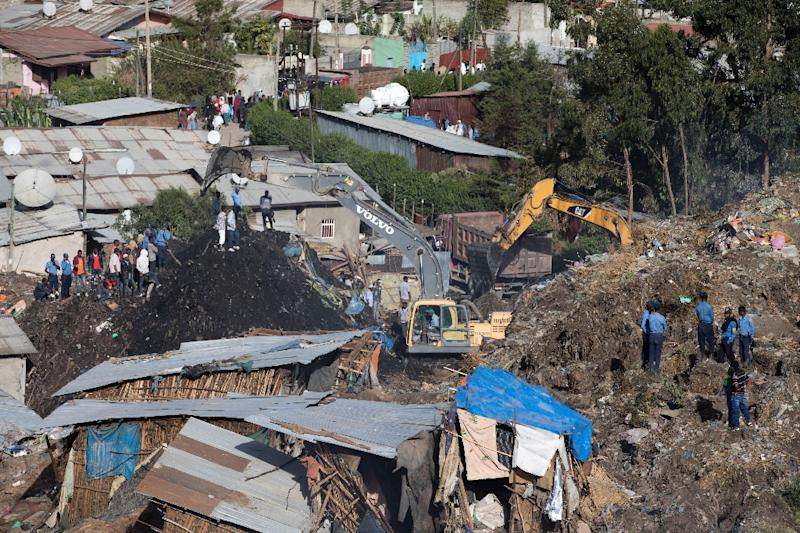 Excavators move earth as rescuers work at the site of a landslide at the main landfill of Addis Ababa (AFP Photo/ZACHARIAS ABUBEKER)