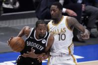 Brooklyn Nets forward Kevin Durant (7) works to the basket against Dallas Mavericks forward Dorian Finney-Smith (10) during the second half of an NBA basketball game in Dallas, Thursday, May 6, 2021. (AP Photo/Tony Gutierrez)