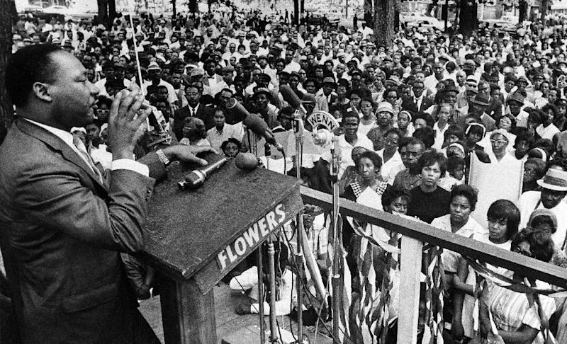 FILE - In this April 30, 1966 photo, The Rev. Martin Luther King Jr. addresses a crowd of some 3,000 persons in Birmingham, Ala., in Kelly Ingram Park on the last day of his three-day whistle-stop tour of Alabama, encouraging black voters to vote as a bloc in the primary election. President Barack Obama signed an order Thursday, Jan. 12, 2017, designating an historic civil rights district in Birmingham as a national monument, placing several blocks of a city once rocked by racial violence on par with landmarks including the Grand Canyon. (AP Photo/JT, File)