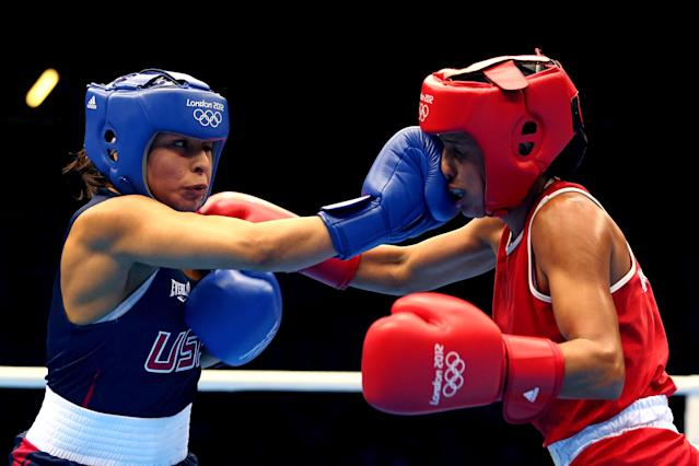 LONDON, ENGLAND - AUGUST 06: Marlen Esparza of the United States competes against Karlha Magliocco of Venezuela during the Women's Fly (51kg) Boxing Quarterfinals on Day 10 of the London 2012 Olympic Games at ExCeL on August 6, 2012 in London, England. (Photo by Scott Heavey/Getty Images)
