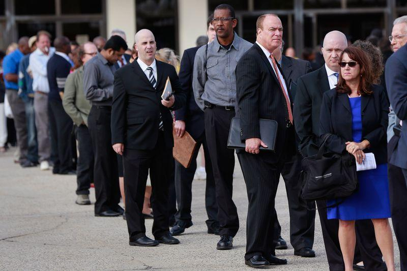People wait in line to enter the Nassau County Mega Job Fair at Nassau Veterans Memorial Coliseum in Uniondale, New York in this file photo