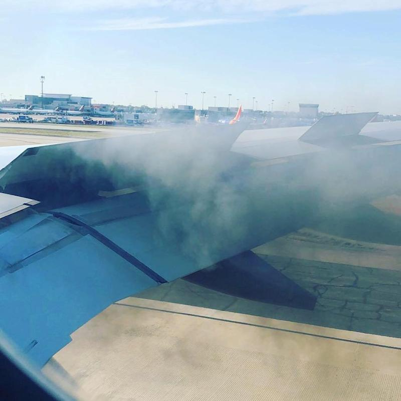 Smoke billows from an engine of the Delta Air Lines plane (REUTERS)