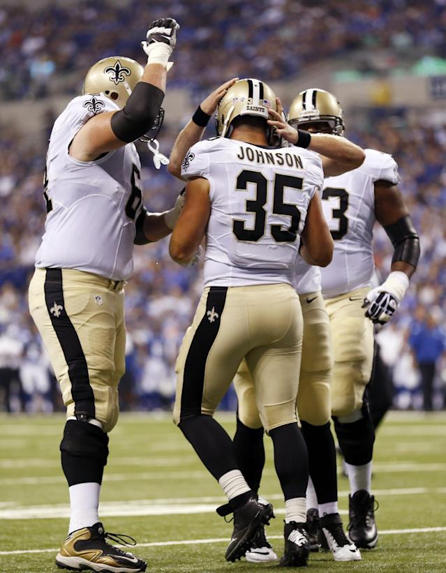 New Orleans Saints fullback Austin Johnson (35) celebrates with teammates after scoring a touchdown against the Indianapolis Colts during the first half of an NFL preseason football game in Indianapolis, Saturday, Aug. 23, 2014. (AP Photo/Sam Riche)