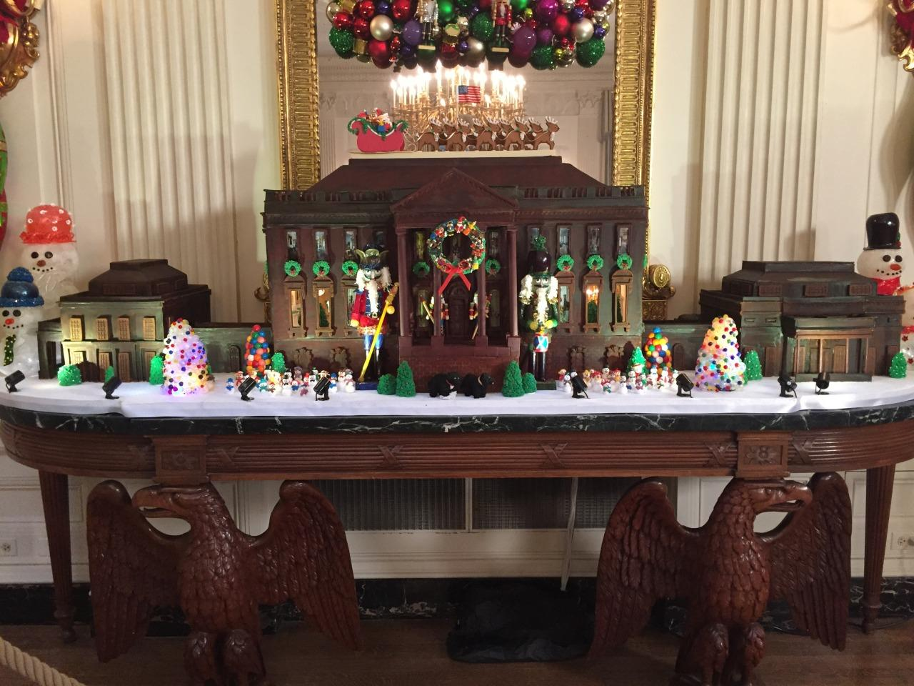 <p>This year's gingerbread house, a tradition started in the Nixon administration, weighs over 500 pounds and is dipped in dark chocolate. For the first time ever, the house features both the east and west wings of the White House. <i>(Photo: Cassie Carothers)</i></p>