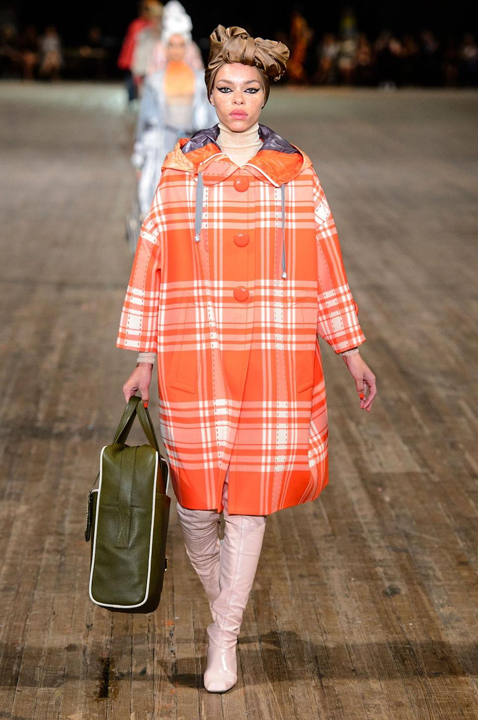 <p>Bright orange plaid collared coat from the SS18 Marc Jacobs collection. (Photo: ImaxTree) </p>