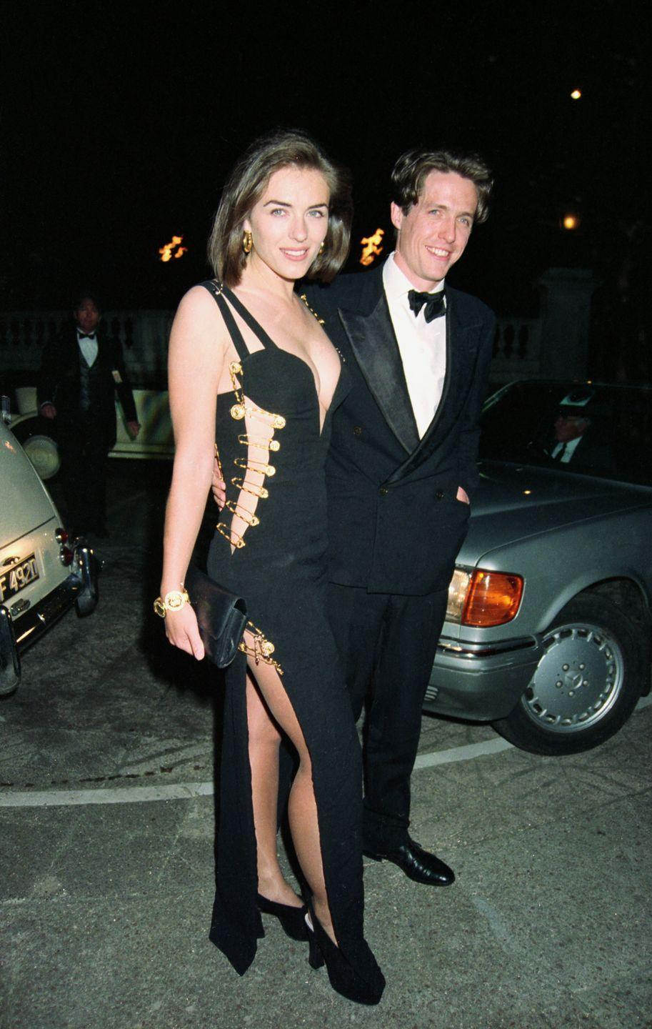 <p>In 1994, Elizabeth Hurley made fashion history in this black Versace gown that was held together by oversized gold safety pins (of course). Hurley was just going to the premiere of <em>Four Weddings and a Funeral</em> as Hugh Grant's guest (they were dating at the time), but she clearly stole the show.<br></p>