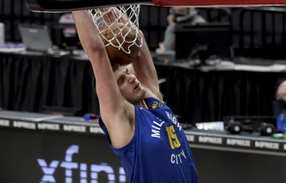 Denver Nuggets center Nikola Jokic dunks during the first half of the team's NBA basketball game against the Portland Trail Blazers in Portland, Ore., Wednesday, April 21, 2021. (AP Photo/Steve Dykes)