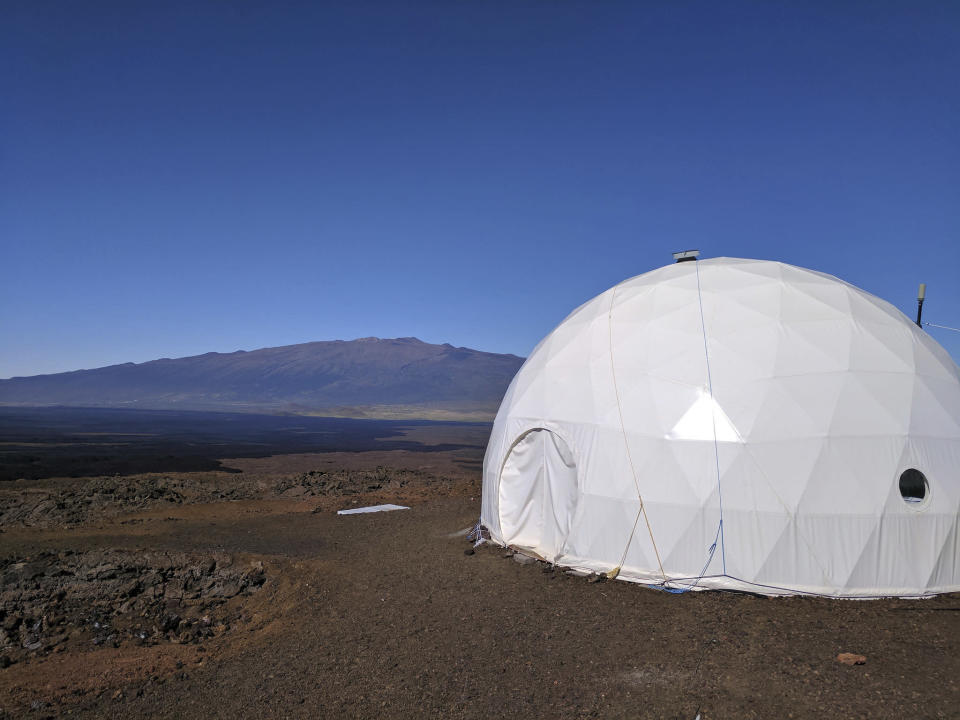 In this photo provided by the University of Hawaii, six carefully selected scientists entered a geodesic dome called Hawaii Space Exploration Analog and Simulation, or HI-SEAS, located 8,200 feet above sea level on Mauna Loa on the island of Hawaii, Thursday, Jan. 19, 2017. The four men and two women moved into their new simulated space home Thursday afternoon, as part of a human-behavior study that could help NASA as it draws up plans for sending astronauts on long missions to Mars. (University of Hawaii via AP)