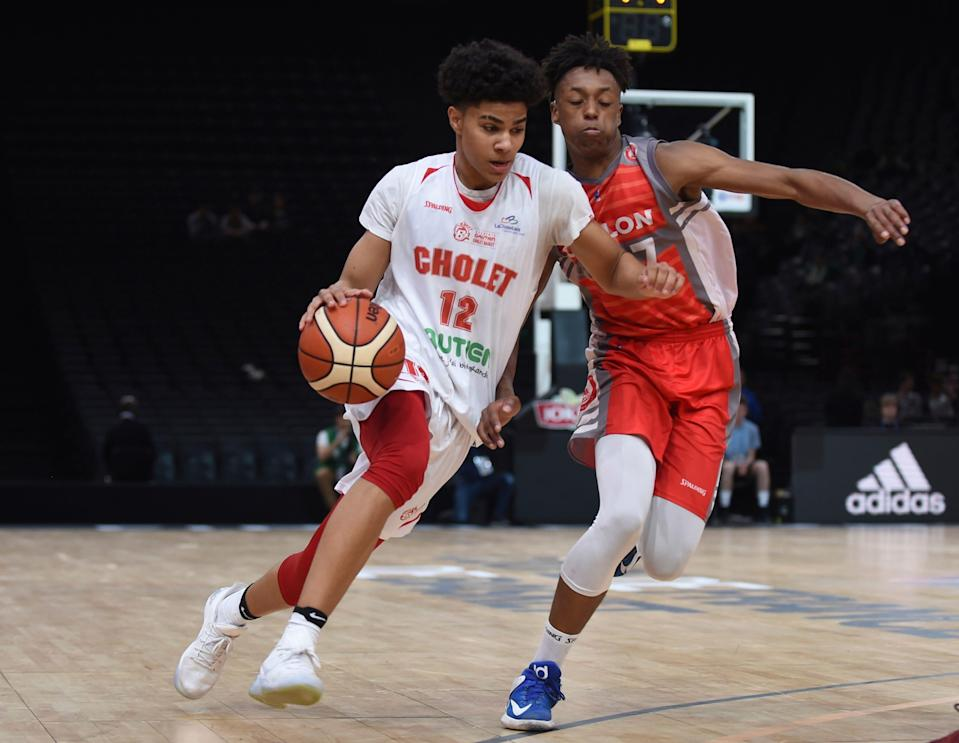 Cholet's Killian Hayes, left, drives during the French Cup under-17 final in Paris on April 22, 2017.