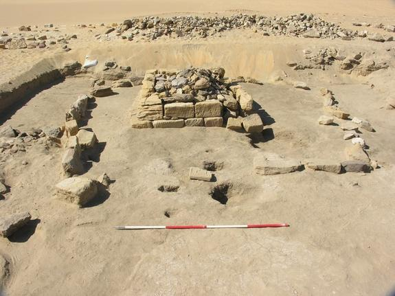 Beneath this pyramid in Sudan, archaeologists found a burial chamber holding the skeletal remains of three young children, buried with faience beads.