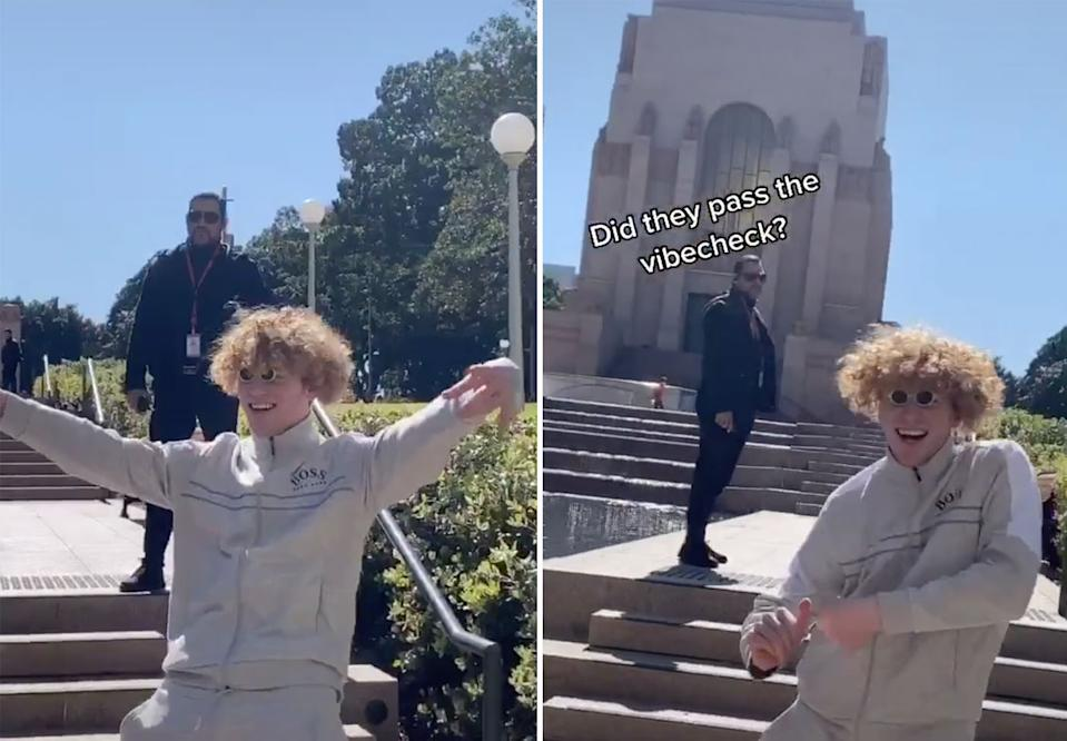 Tate 'vibes' in front of a security guard at the memorial who appears to be ushering him away from the area. Source: TikTok