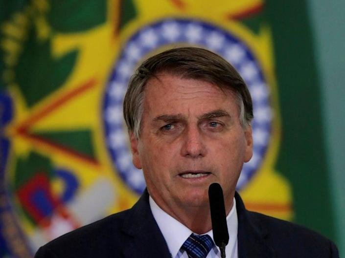 Brazillian president Jair Bolsonaro is is attempting to push through a suite of land regulation bills that could put millions of hectares of public land in the Amazon at risk, campaigners say (REUTERS)