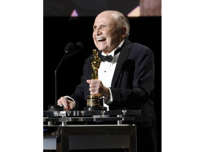 FILE - In this Saturday, Nov. 12, 2016 file photo, Honoree Lynn Stalmaster accepts his award at the 2016 Governors Awards at the Dolby Ballroom in Los Angeles. Lynn Stalmaster, the Oscar-winning casting director whose eye for talent helped launch the careers of John Travolta, Christopher Reeve, Richard Dreyfuss and many other actors, has died. He was 93.(Photo by Chris Pizzello /Invision/AP, File)