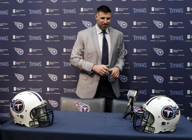 New Tennessee Titans head football coach Mike Vrabel leaves his introductory news conference. (AP)