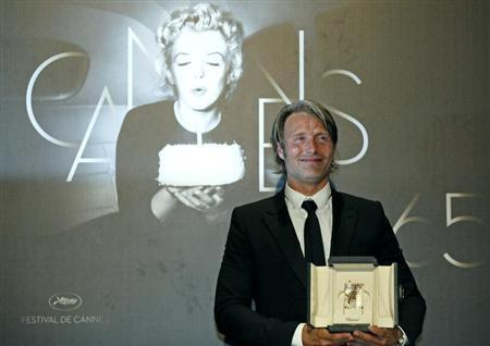 Best Actor award winner Mikkelsen for the film Jagten poses during a photocall after the awards ceremony of the 65th Cannes Film Festival