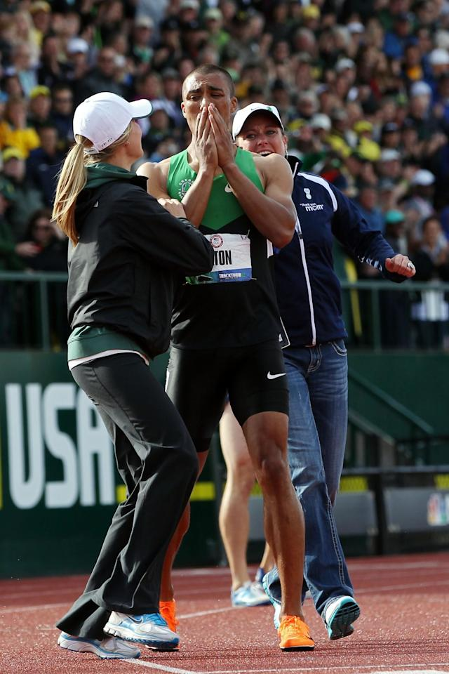 <p>Ashton Eaton celebrates with his girlfriend Brianne Theisen (L) and mother Roslyn Eaton (R) after breaking the world record in the men's decathlon after competing in the 1500 meter run portion during Day Two of the 2012 U.S. Olympic Track & Field Team Trials at Hayward Field on June 23, 2012 in Eugene, Oregon. (Photo by Christian Petersen/Getty Images) </p>