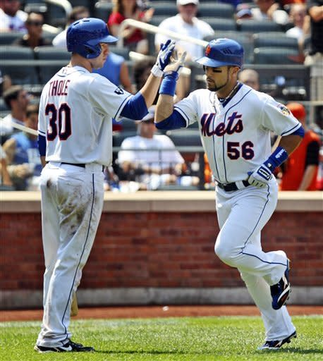 New York Mets' Andres Torres, right, is greeted by Josh Thole after hitting a solo home run during the sixth inning of a baseball game against the Miami Marlins, Thursday, Aug. 9, 2012 at Citi Field in New York. (AP Photo/Seth Wenig)