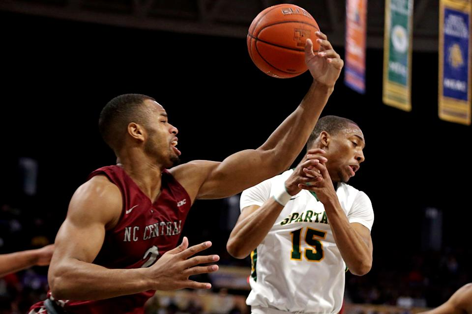 Mar 16, 2019; Norfolk, VA, USA; North Carolina Central Eagles forward Jibri Blount (2) knocks the ball away from Norfolk State Spartans guard C.J. Kelly (15) during the first half in the MEAC Tournament Final at The Scope. Mandatory Credit: