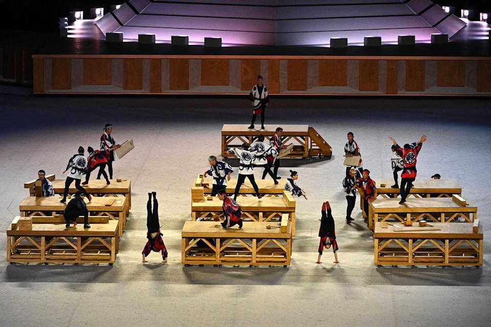 """<p>The opening ceremony also highlighted a unique part of Japan's history and culture, with a group of tap dancers <a href=""""https://people.com/sports/tokyo-olympics-tap-dancing-edo-worksong/"""" rel=""""nofollow noopener"""" target=""""_blank"""" data-ylk=""""slk:performing a traditional work song"""" class=""""link rapid-noclick-resp"""">performing a traditional work song</a> called the """"Kiyari Uta,"""" dressed as carpenters. </p>"""